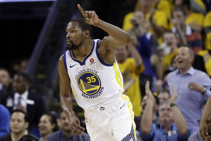 48869702a63 Golden State Warriors forward Kevin Durant reacts after scoring against the  Cleveland Cavaliers during the second