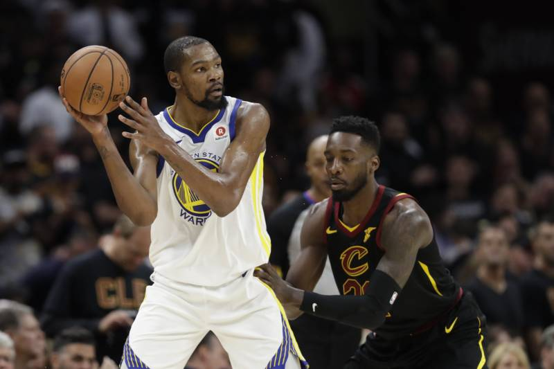 a19388816d9 Golden State Warriors  Kevin Durant is defended by Cleveland Cavaliers  forward Jeff Green (32