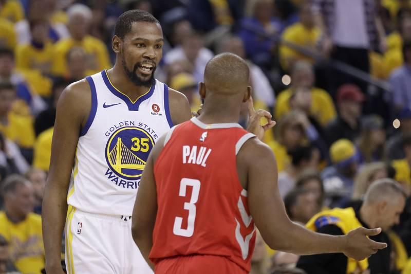 848e9f1a0b56 Golden State Warriors forward Kevin Durant (35) looks toward Houston  Rockets guard Chris Paul