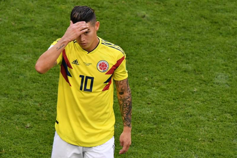 c36f55f56d2 Colombia's midfielder James Rodriguez reacts as he leaves the football  pitch due to an injury during