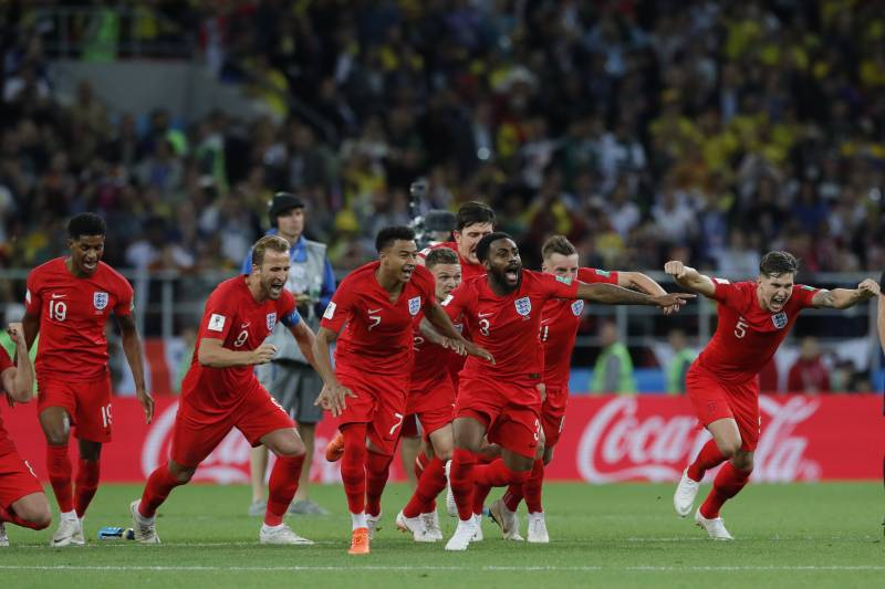England's players celebrate after defeated Colombia in a penalty shoot out during the round of 16 match between Colombia and England at the 2018 soccer World Cup in the Spartak Stadium, in Moscow, Russia, Tuesday, July 3, 2018. (AP Photo/Ricardo Mazalan)