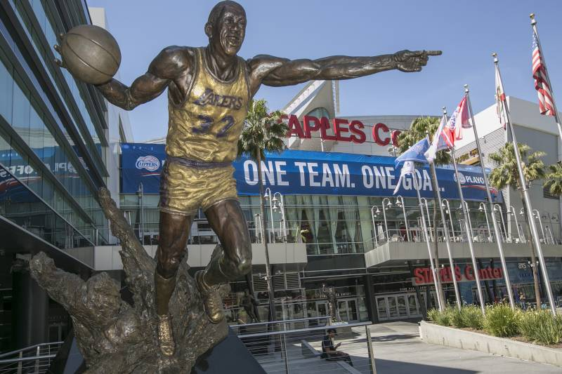 2e9f0410f125 A statue of Los Angeles Lakers basketball player Magic Johnson is displayed  outside of the Staples