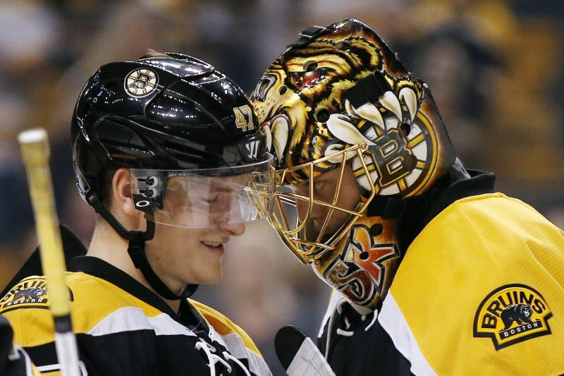 12b86807c6b Boston Bruins' Torey Krug (47) celebrates with teammate Tuukka Rask, of  Finland