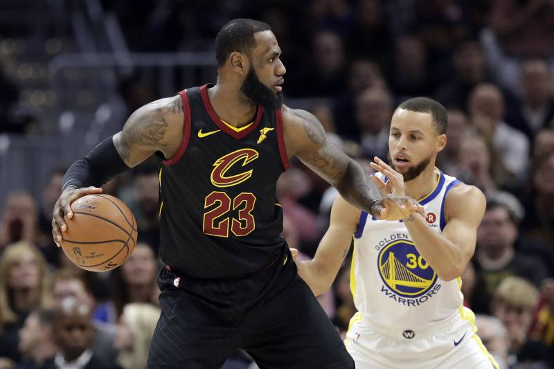 61e33e46e6cd Cleveland Cavaliers' LeBron James is defended by Golden State Warriors'  Stephen Curry in the