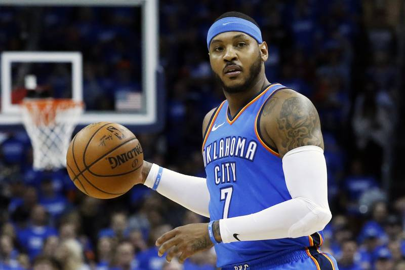 FILE - This is an April 25, 2018, file photo showing Oklahoma City Thunder forward Carmelo Anthony (7) during Game 5 of an NBA basketball first-round playoff series against the Utah Jazz, in Oklahoma Cit. Carmelo Anthony has played his last game for the Oklahoma City Thunder, barring a massive change of plans. A person with knowledge of the negotiations said Friday, July 6, 2018, that Anthony and the Thunder have mutually decided that he will not be on the team next season, though it remains unclear how that departure will actually happen. The person spoke on condition of anonymity to The Associated Press because no buyout, trade or waiving has been executed. (AP Photo/Sue Ogrocki, File)
