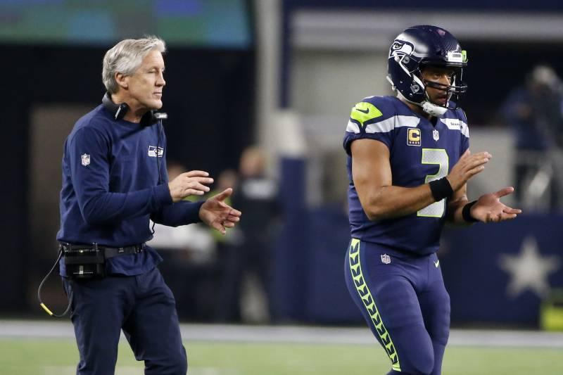 b38bebfd3f6 Seattle Seahawks head coach Pete Carroll and quarterback Russell Wilson  walk onto the field in the