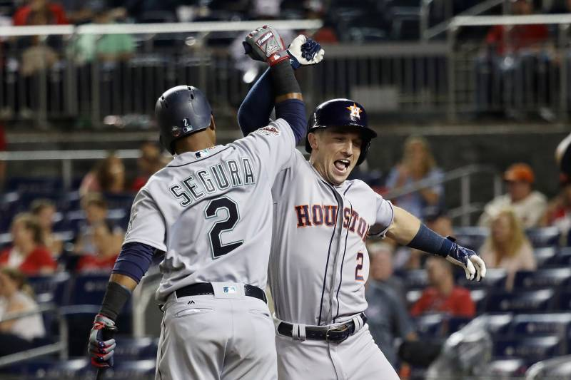 WASHINGTON, DC - JULY 17: Alex Bregman #2 of the Houston Astros and the American League celebrates with Jean Segura #2 of the Seattle Mariners and the American League after hitting a solo home run in the tenth inning against the National League during the 89th MLB All-Star Game, presented by Mastercard at Nationals Park on July 17, 2018 in Washington, DC. (Photo by Rob Carr/Getty Images)