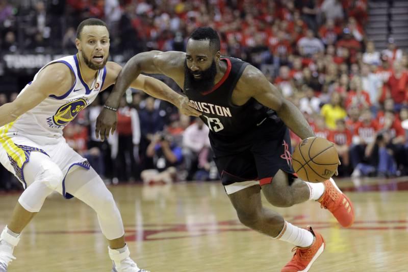 1b270bb1861 Houston Rockets guard James Harden (13) drives around Golden State Warriors  guard Stephen Curry