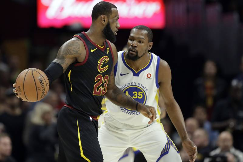 ce09112dffe Cleveland Cavaliers  LeBron James is defended by Golden State Warriors  Kevin  Durant in the