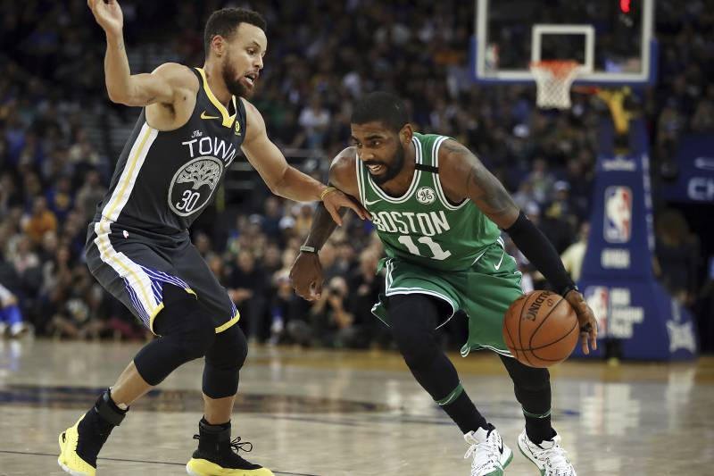 official photos d55da a2953 Boston Celtics  Kyrie Irving, right, drives the ball against Golden State  Warriors