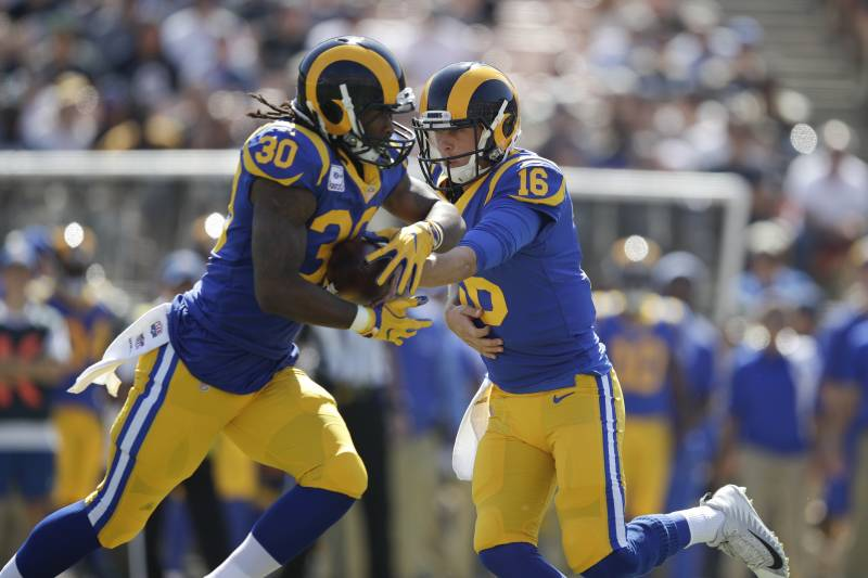 bd71cc4493b Los Angeles Rams quarterback Jared Goff hands the ball to Todd Gurley  during an NFL football