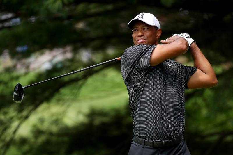 AKRON, OH - AUGUST 03: Tiger Woods plays his shot from the second tee
