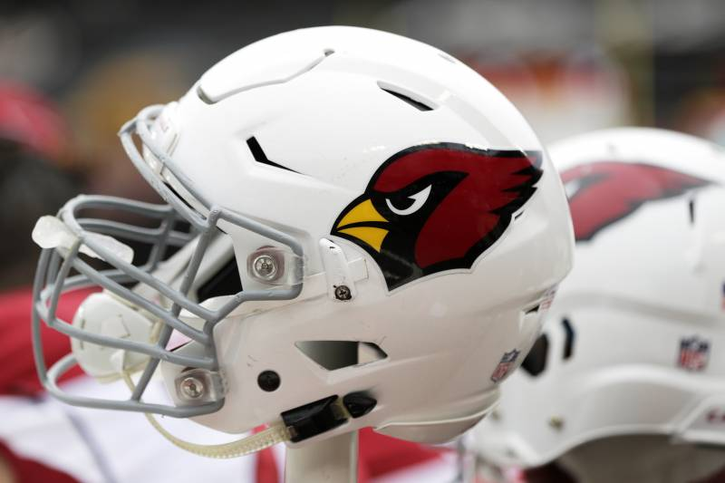 77cb7e58883c An Arizona Cardinals helmet sits on the bench during an NFL football game  between the Arizona