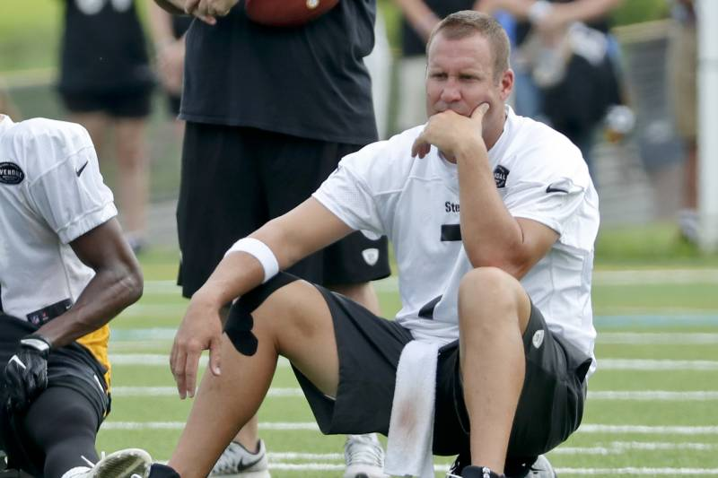 0dd0822c744 Pittsburgh Steelers quarterback Ben Roethlisberger sits on his helmet at  practice during NFL football training camp