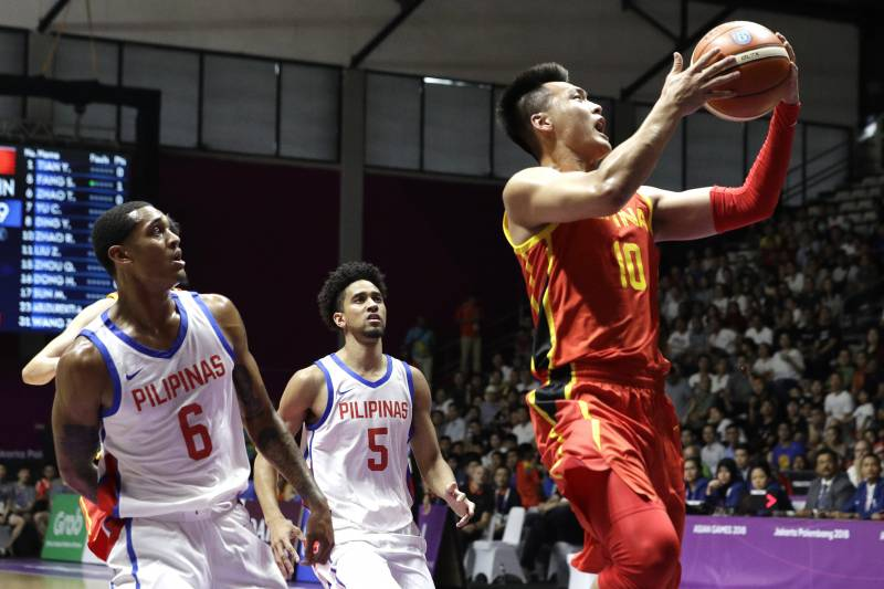 dc95ee5d8d2 China's Rui Zhao, right, shoots for a basket as Philippines' Jordan Clarkson ,