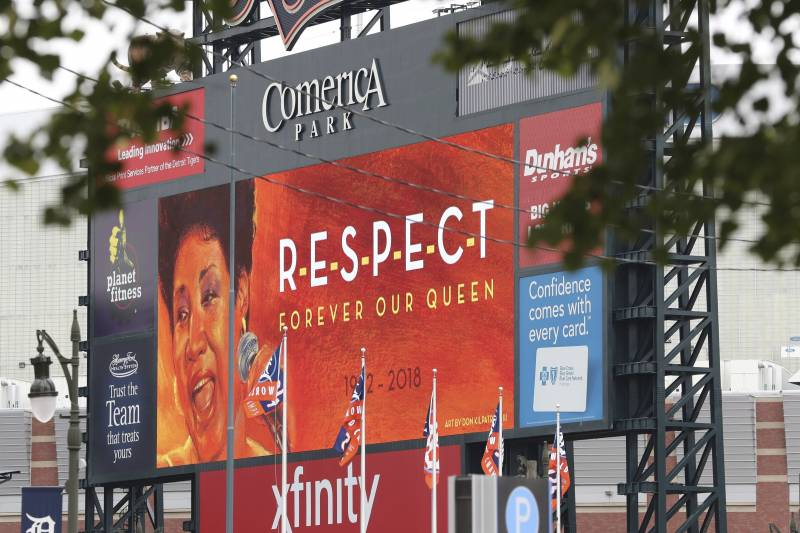 The scoreboard at Comerica Park, home of the Detroit Tigers, displays a tribute to Aretha Franklin, Thursday, Aug. 16, 2018, in Detroit. Franklin died Thursday at her home in Detroit. She was 76. (AP Photo/Carlos Osorio)