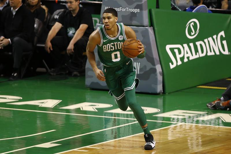 hot sale online aade4 9a369 Boston Celtics  Jayson Tatum brings the ball up court against the Los  Angeles Lakers during