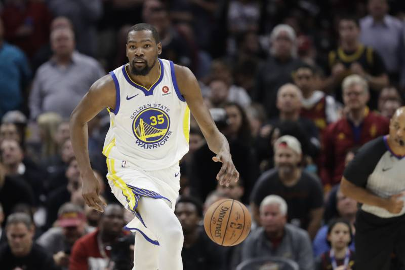 25eac736353c Comments. Golden State Warriors  Kevin Durant dribbles in the first half of  Game 3 of basketball s