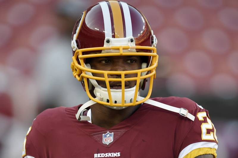 Washington Redskins running back Adrian Peterson warms up before a preseason NFL football game against the Denver Broncos, Friday, Aug. 24, 2018, in Landover, Md. (AP Photo/Nick Wass)