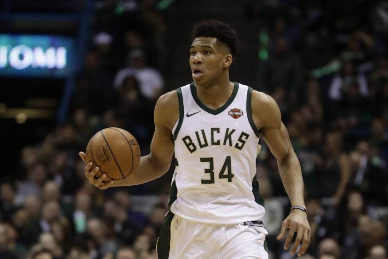Milwaukee Bucks  Giannis Antetokounmpo dribbles during the first half of  Game 3 of an NBA 3301f29a9