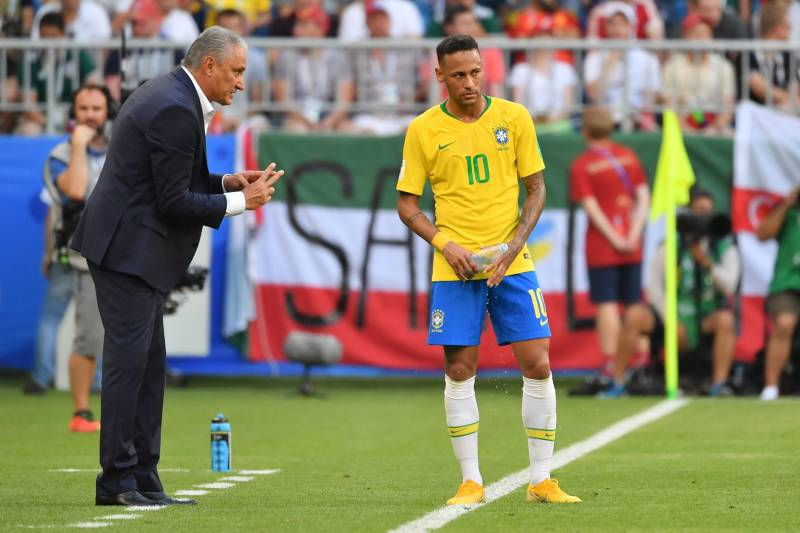5538298a8e5 Brazil's coach Tite talks to Brazil's forward Neymar during the Russia 2018 World  Cup round of