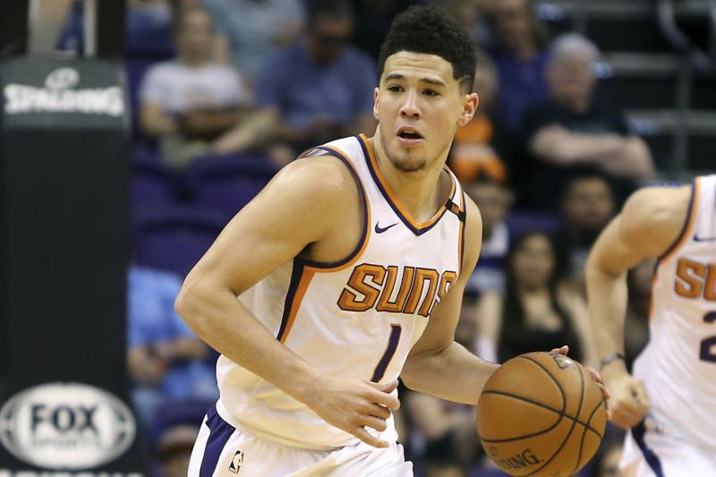 6baa5392cf6 Phoenix Suns guard Devin Booker (1) advances the ball up court during the  second