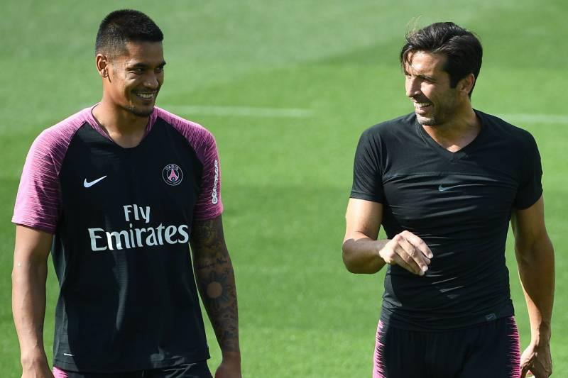 1e0a419a9 Paris Saint-Germain s French goalkeeper Alphonse Areola (L) speaks and  laughs with Paris