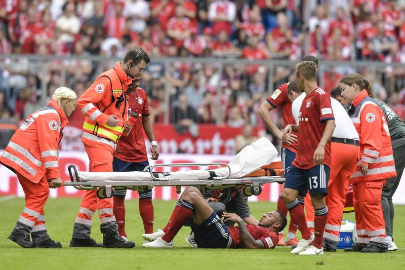 Bayern Munich's French midfielder Corentin Tolisso lies injured on the pitch during the German First division Bundesliga football match between FC Bayern Munich and Bayer Leverkusen in Munich, on September 15, 2018. (Photo by Guenter SCHIFFMANN / AFP) / DFL REGULATIONS PROHIBIT ANY USE OF PHOTOGRAPHS AS IMAGE SEQUENCES AND/OR QUASI-VIDEO (Photo credit should read GUENTER SCHIFFMANN/AFP/Getty Images)