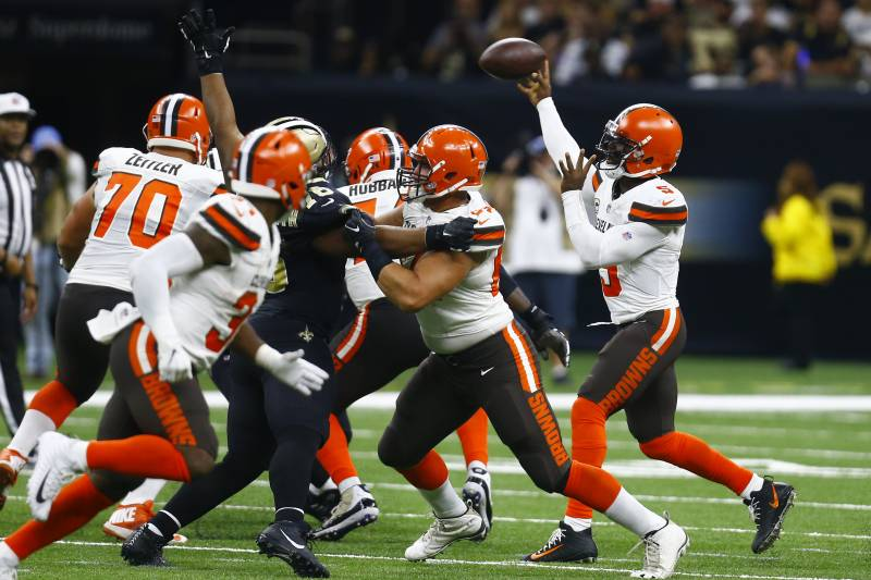 2393fe27d47 Cleveland Browns quarterback Tyrod Taylor, right, passes during the second  half of an NFL