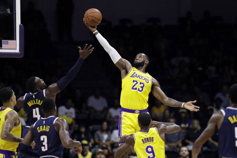 f74cdf7b3f1 Los Angeles Lakers forward LeBron James (23) grabs a rebound over Denver Nuggets  forward