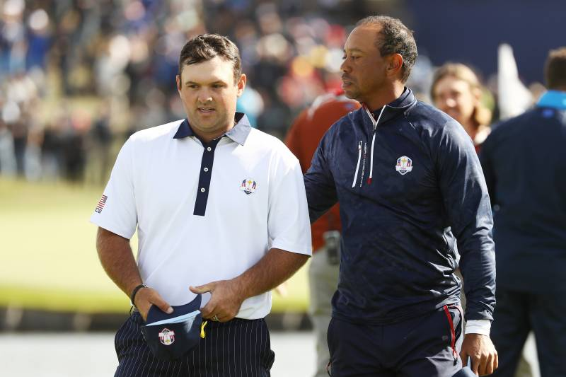 46d656755b1 PARIS, FRANCE - SEPTEMBER 29: Tiger Woods of the United States consolls  Patrick Reed