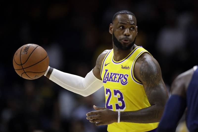 10c33e7a451 Los Angeles Lakers forward LeBron James looks to pass during the first half  of an NBA