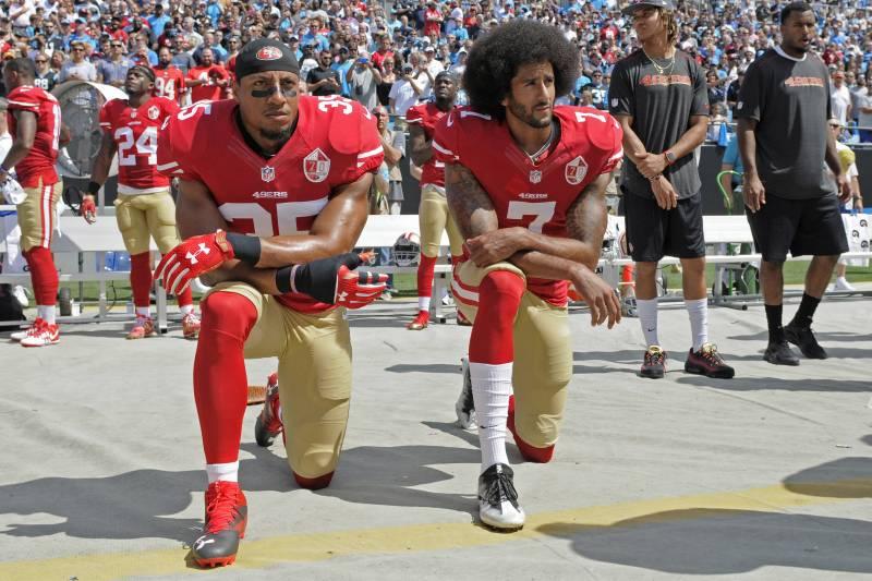 58452a1b915 San Francisco 49ers  Colin Kaepernick (7) and Eric Reid (35) kneel