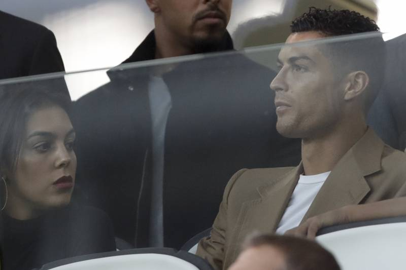 dd0df582a Juventus forward Cristiano Ronaldo and his partner Georgina sit in the  stands prior to the Champions