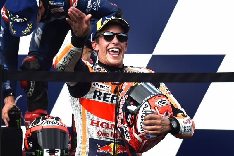 eaa2e09b0f4f Repsol Honda Team s Spanish rider Marc Marquez celebrates on the podium  after winning the MotoGP race