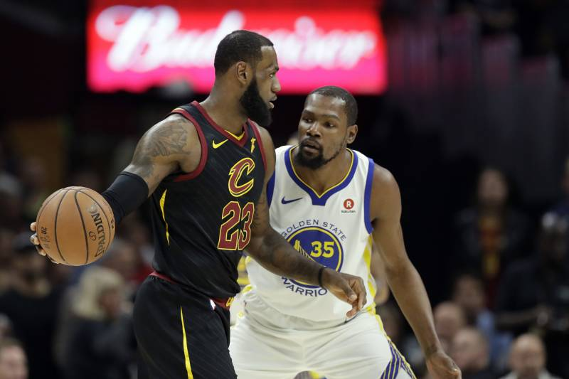 6a8ab99c8d56 Cleveland Cavaliers  LeBron James is defended by Golden State Warriors  Kevin  Durant in the