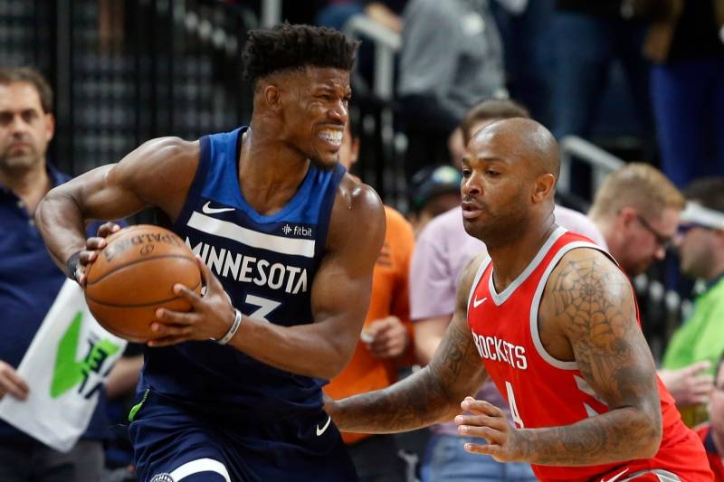 eaaeee2a3fa Minnesota Timberwolves' Jimmy Butler, left, keeps the ball close as Houston  Rockets'