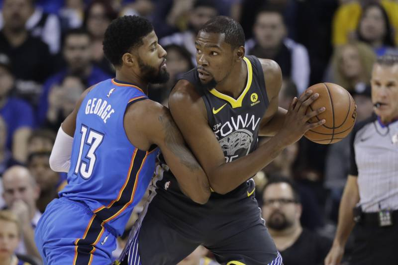 9895bd7c732 Golden State Warriors  Kevin Durant is defended by Oklahoma City Thunder s  Paul George (13