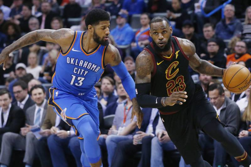 5ba9a7201f8 Cleveland Cavaliers forward LeBron James (23) drives past Oklahoma City  Thunder forward Paul George