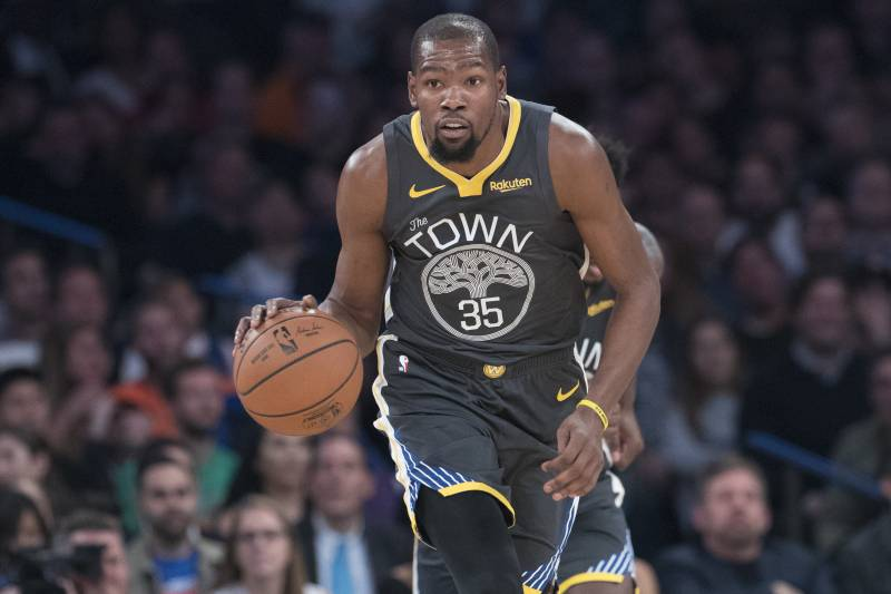 low priced f10b6 bf647 Golden State Warriors forward Kevin Durant handles the ball during the  first half of an NBA