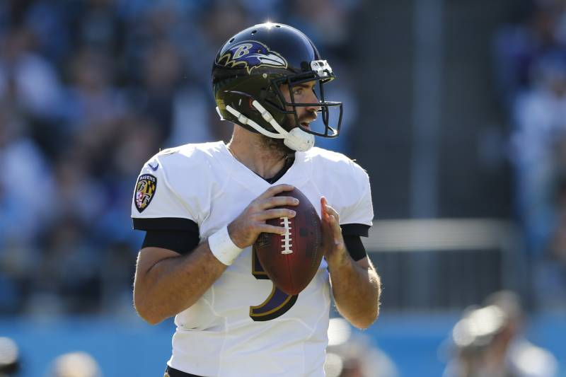 647eb1fe0 Baltimore Ravens  Joe Flacco (5) looks to pass against the Carolina Panthers  in