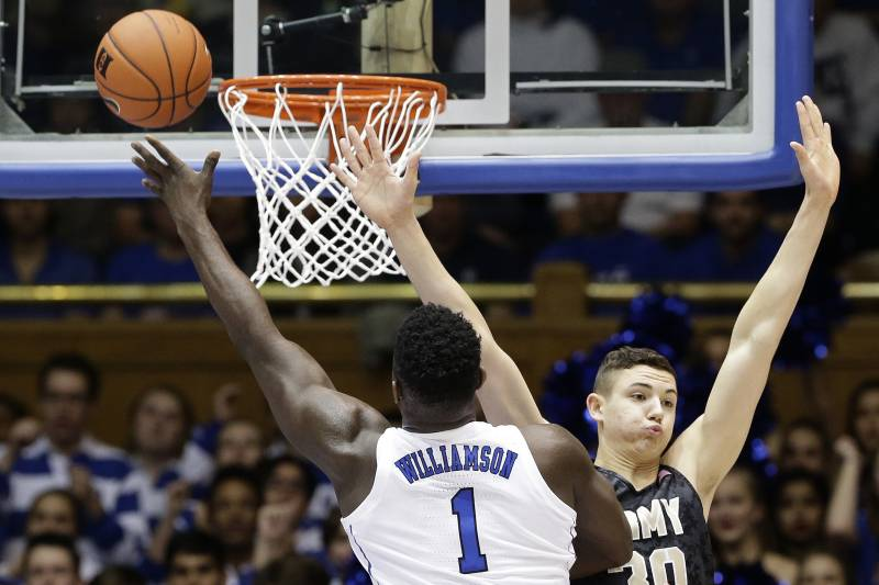 7de4d049fd8e Duke s Zion Williamson (1) drives to the basket as Army s Ben Kinker (30