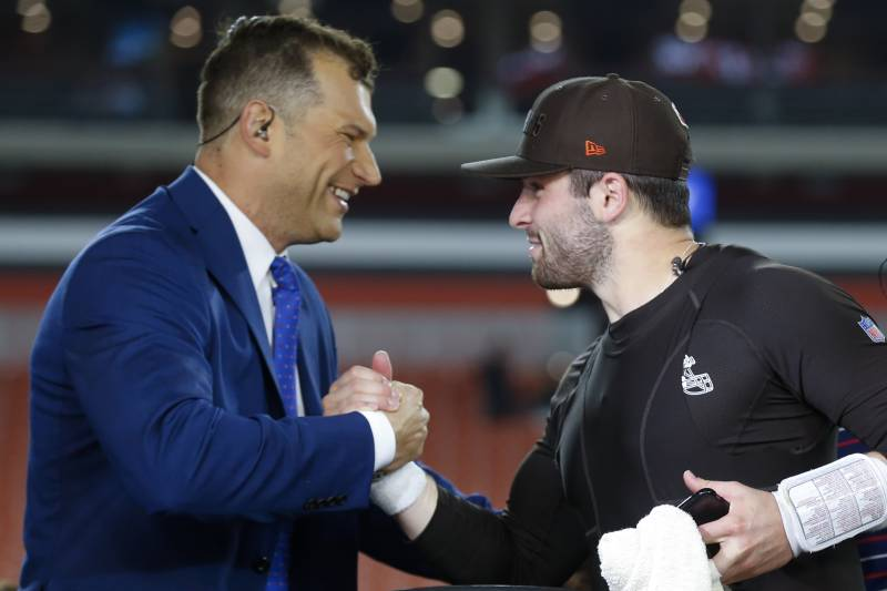 04d78f9ebc7 Cleveland Browns quarterback Baker Mayfield, right, shakes hands with  former Cleveland Browns tackle Joe