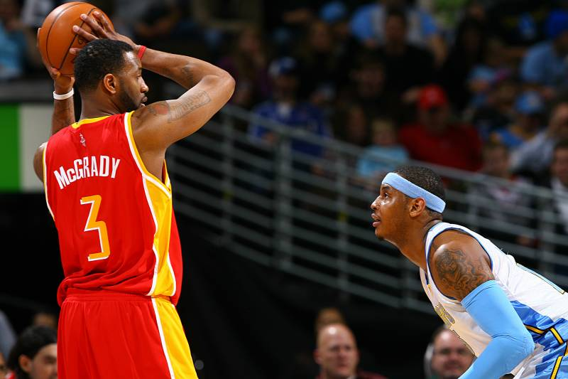 d7e41375b79 DENVER - DECEMBER 16  Tracy McGrady  3 of the Houston Rockets goes to the