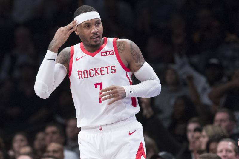 f94ee88eb64 Houston Rockets forward Carmelo Anthony (7) reacts after scoring a  three-point basket