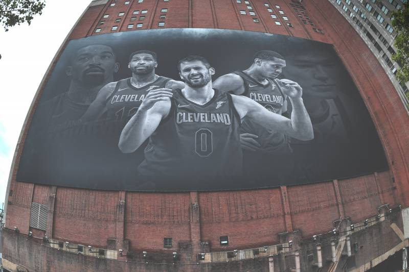 20bade7677d A fan poses for a photo in front of a mural of Cleveland Cavaliers forward  LeBron
