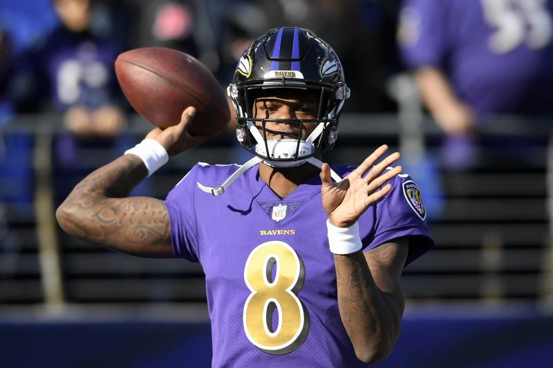 9631ef801113 Baltimore Ravens quarterback Lamar Jackson warms up before an NFL football  game against the Oakland Raiders