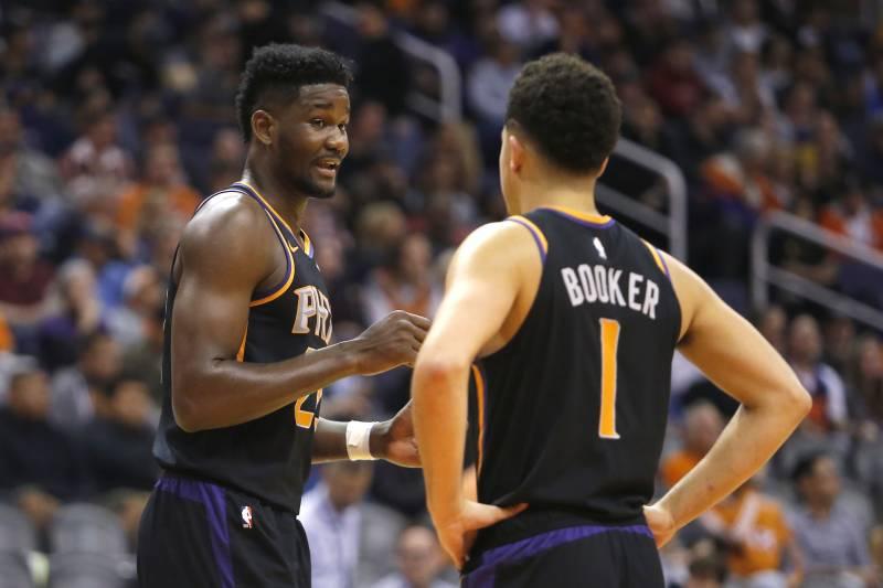 d56cc618d Phoenix Suns center Deandre Ayton (22) and Devin Booker (1) in the