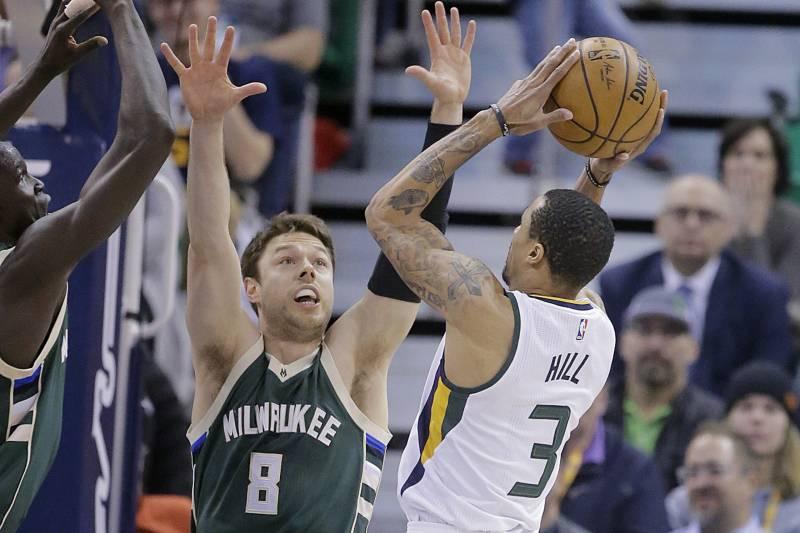 9c089611dd71 Utah Jazz guard George Hill (3) shoots as Milwaukee Bucks guard Matthew  Dellavedova (