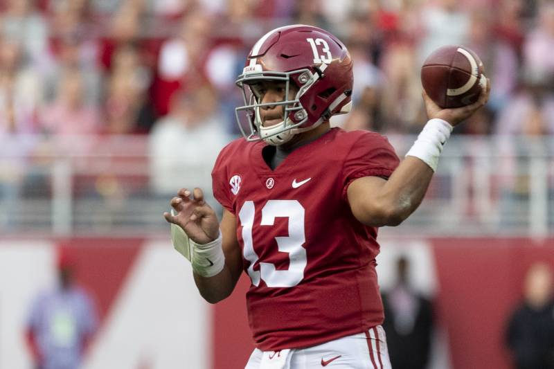 buy online 88831 fd364 Alabama quarterback Tua Tagovailoa (13) drops back to pass against Auburn  during the first. Vasha Hunt Associated Press. With the College Football ...
